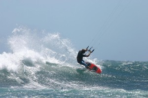 Kitesurfing wave riding in Tarifa Spain Vadevaqueros kite beach with Tarifa Max kitesurfing. Book your strap less kite lesson at info@tarifamax.net